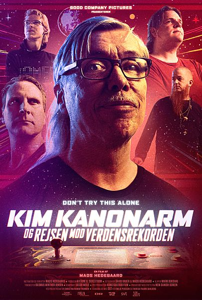 "Movie poster for ""KIM KANONARM OG REJSEN MOD VERDENSREKORDEN"""